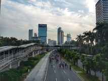 Sunday Morning in Jakarta. Car free day on Sunday morning in Jalan Jenderal Sudirman Jakarta Indonesia. People doing sport activities along the road Royalty Free Stock Photos