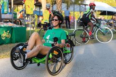 Woman smiling on her recumbent bike, editorial. royalty free stock images