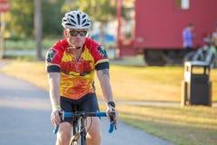 Close up male bike rider approaching camera.. stock photo