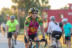 Woman riding her bike toward camera. royalty free stock images