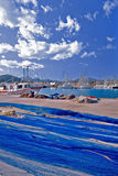 On Sunday they rest. A small but busy fishing port in Mallorca, Spain. Not a soul on the pier on a Sunday morning Royalty Free Stock Image