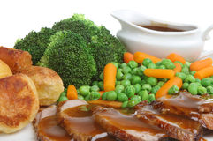 Sunday Roast Lamb Dinner. Traditional roast lamb dinner with individual gravy boat Royalty Free Stock Images