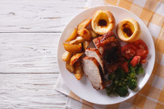 Sunday Roast on the plate close up on the table. horizontal top Stock Photos