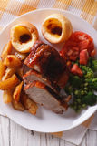 Sunday Roast on the plate closeup vertical top view Stock Photo