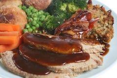 Sunday Roast Pork Dinner. Traditional Sunday roast pork dinner with rich gravy Stock Photography