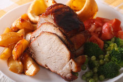 Sunday roast: pork with vegetables and Yorkshire pudding. Horizo Royalty Free Stock Photography