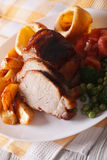 Sunday roast: pork with vegetables and Yorkshire pudding. Vertic Royalty Free Stock Photo