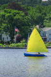 Sunday Sail. Weekend sailor solo sails his cat-rigged sailoboat on the Connecticut River Royalty Free Stock Images