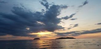 Sundown by the sea stock photos