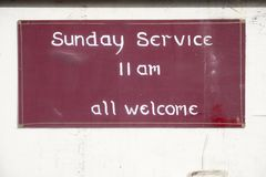 Sunday service all welcome sign at church for religious worship. Uk royalty free stock photos