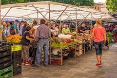 Sunday Shopping, Pollensa Market, Mallorca. People shopping at the weekly Sunday market in Pollensa, Mallorca Stock Image