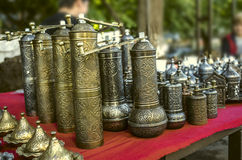 Sunday souvenir sale with coffee mill from brass. With relief ornament royalty free stock image
