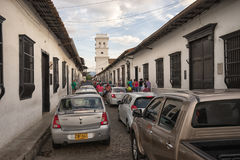 Sunday traffic in Giron Colombia. July 23, 2017 Giron, Santander: traffic backed up on the narrow street on a Sunday in the tropical colonial town Royalty Free Stock Image