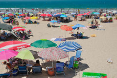 Sunday trippers. Crowded Andalusian beach in a sunday of summer Royalty Free Stock Photos