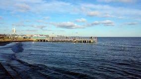 Sunday walk by the sea. Gdynia, Poland - January 07, 2018: Sunday walk by the sea, people feed birds Stock Photo