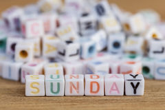 Sunday written in letter beads on wood background Stock Photo