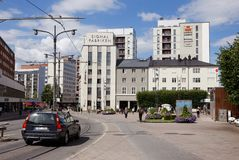 Sundbyberg square. Sundbyberg, Swden - August 2, 2017: The street Landsvagen with tramway tracks at Sunbyberg square with Signalfabriken building in the Stock Photo