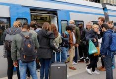 Passengers and commuter train. Sundbyberg, Sweden - September 8, 2017:  Commuter train in service Greater Stockholm public transportation at Sundbyberg station Stock Photos