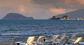 Sundecks on Laganas beach at sunset. In Zakynthos island, Greece royalty free stock images