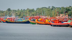 Wooden boats painted with different colors line the banks of the River Ganges for tourist to hire royalty free stock photography