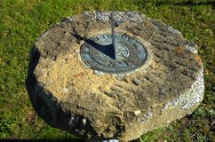 Sundial. An old corroded sundial set into a stone slab Royalty Free Stock Photos