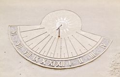 Sundial. With sun symbol on a wall Royalty Free Stock Photography