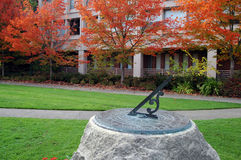 Sundial. With fall colors in background Stock Image