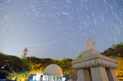 Sundial, Airplane trail and Star trail Stock Photo