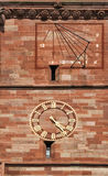 Sundial and clock on Basel Cathedral, Switzerland Royalty Free Stock Photos