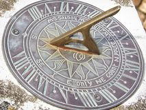 Sundial clock face with roman numerals. Clocks timepiece sun dial royalty free stock images