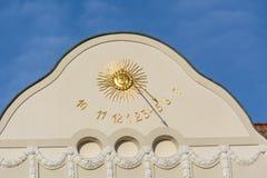 Sundial clock on a house facade Royalty Free Stock Photo