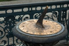 Sundial closeup in the winter moist water drops zoomed in stock photography