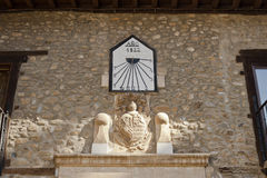 Sundial and coat of arms in Villafranca del Bierzo. Royalty Free Stock Images