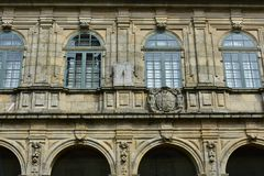 Sundial in cloister. Stone walls, green wood windows, archs and details. Santiago de Compostela. Spain. stock images