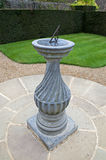 Sundial in a formal garden stock image