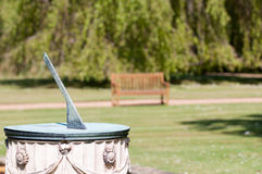 Sundial in natural daylight with blurred background Stock Image