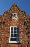 Sundial in an old building Facade Stock Photography