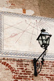 Sundial over a wall Stock Photography