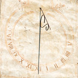 Sundial with roman numeral indicating twelve. Antique restored sundial with roman numeral indicating twelve stock photo