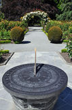 The sundial and rose arch Royalty Free Stock Photography