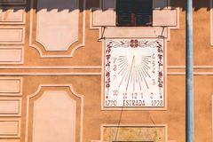 Sundial on an old wall where it is written in Catalan - 1790 roa Royalty Free Stock Photo
