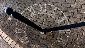 Sundial on the sidewalk stock photography