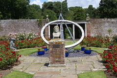 Sundial and The statue of  John Flamsteed at Herstmonceux Castle in England Stock Photos