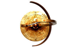 Sundial top. A rusty steel sundial taken from above showing compass points royalty free stock images