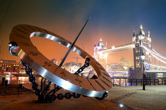 Sundial and Tower Bridge Royalty Free Stock Photos