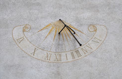 Sundial on the Town tower, city Roznava, Slovakia. The Town tower was built between 1643 and 1654, in the middle of the square royalty free stock photography