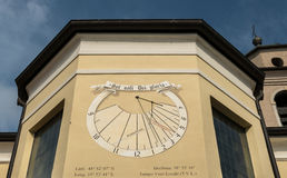 Sundial. On the wall of a church tower. Torbole, Trentino, Italy Stock Photography