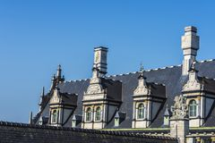 Sundial and windows on the roof of an medieval house Royalty Free Stock Image