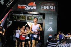 sundown för maraton för 2009 adidasefterbehandlare Arkivbilder