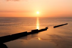 Sundown on Helgoland with wall into the sea Stock Photography